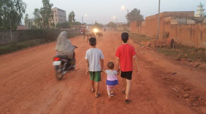 Boys walking with JoJo